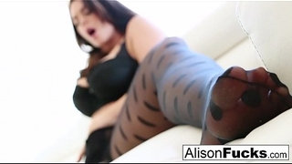 Alison-Tyler-uses-her-long-legs-to-tease-off-her-stockings