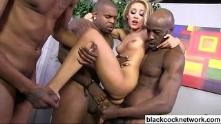 Two-black-cocks-force-their-way-into-blondes-holes