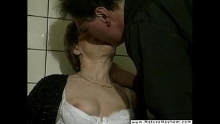 A-really-old-dirty-granny-performing-a-jawbreaking-blowjob