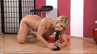Amateur-blonde-Iris-rides-and-cums-from-a-massive-dildo