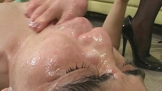 Mistress-dominates-slave-by-feet-as-he-masturbates