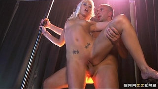 Beautiful-blonde-stripper-grinds-her-wet-pussy-on-her-man's-big-dick