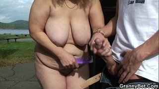 Blonde-granny-ride-stranger's-cock-on-public