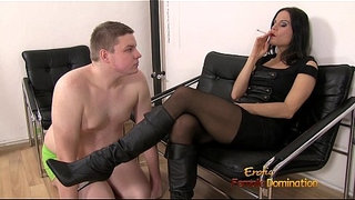 Female-Dominatrix-Using-A-Slave-Like-An-Ashtray