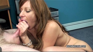 Mature-tart-Brandi-Minx-is-on-her-knees-blowing-a-geek